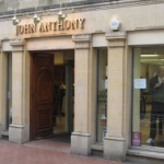 John Anthony designer clothing stores selects retail systems from Eurostop
